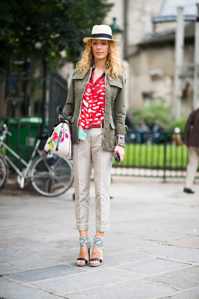 Mix and match all the pieces you love, like this showgoer's artful combination of cherry red blouse, army parka, statement sandals, and hat.