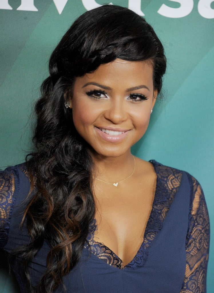 Christina Milian's side braid and curls adds an instant Grecian goddess vibe.