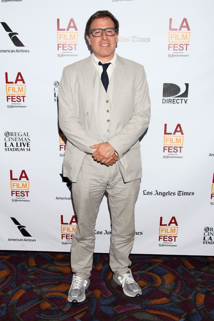 David O. Russell wore a suit with sneakers for a special talk.