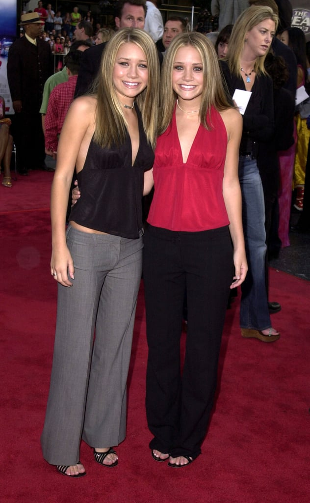 Twinning combo: At the Hollywood premiere of Rush Hour 2, the duo styled silky halter tops with low-slung trousers and the same strappy sandals.  Ashley stayed true to her minimalistic style, working a black-and-gray color scheme. Mary-Kate balanced her fiery red top with classic black pants.