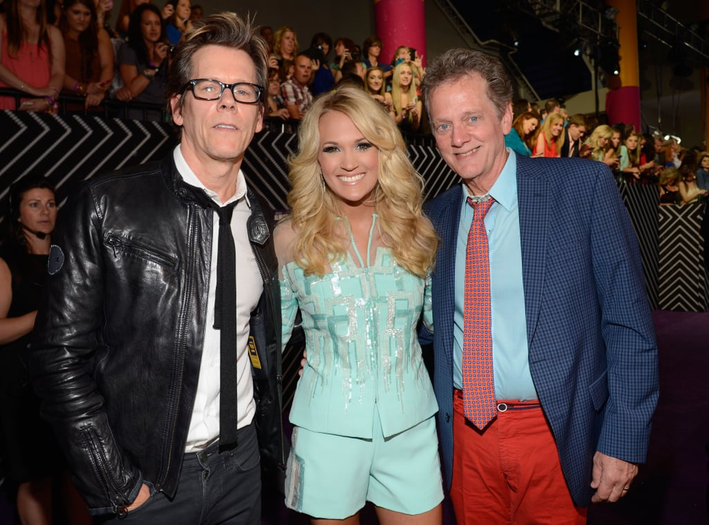Kevin Bacon and his brother Michael posed with Carrie Underwood.
