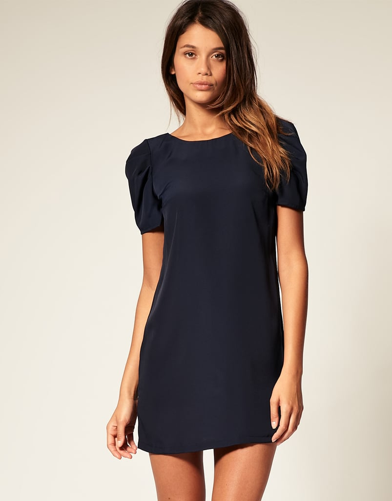Make use of this little shift during the holidays with fabulous jewels, then rewear it throughout the year with all of your wardrobe essentials.  ASOS Shift Dress With Short Puff Sleeves (approx $31)