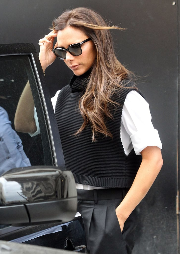 Victoria Beckham's hair blew in the wind when she stepped out in London on Friday.