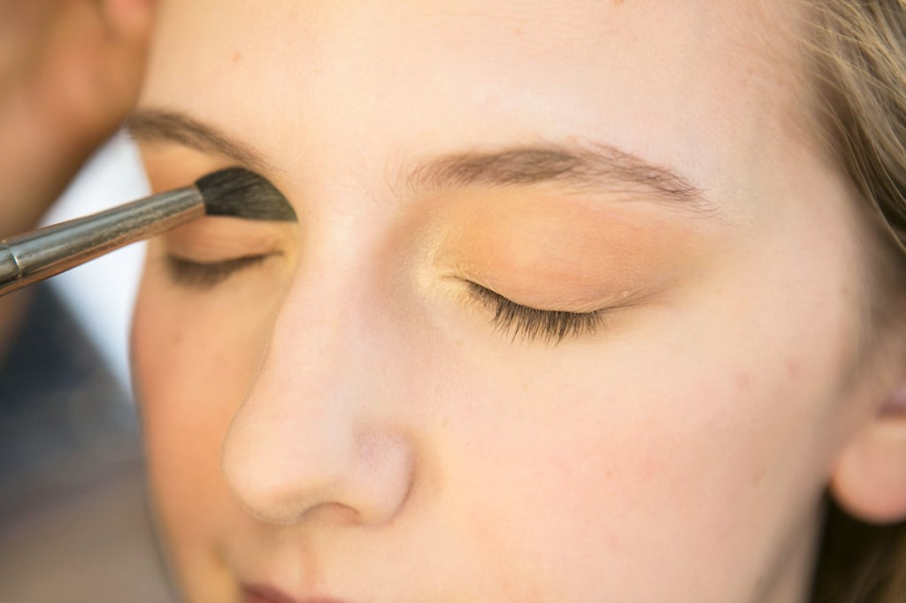 To brighten up the soft brown all over the lids, Bettelli went back with a shimmering gold shadow, which she dusted into the inner corners of the eyes.