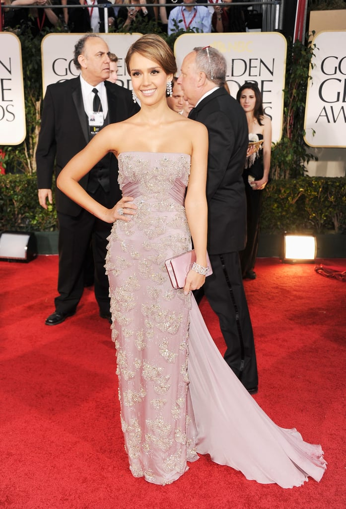 Jessica Alba chose a feminine, strapless blush-tone Gucci gown, complete with sparkly embellishments all over the bodice and train. Her pretty pink clutch and statement diamond accessories topped off this girlie getup.
