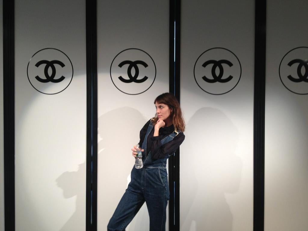 Alexa Chung wore overalls to Chanel. Source: Twitter user alexa_chung