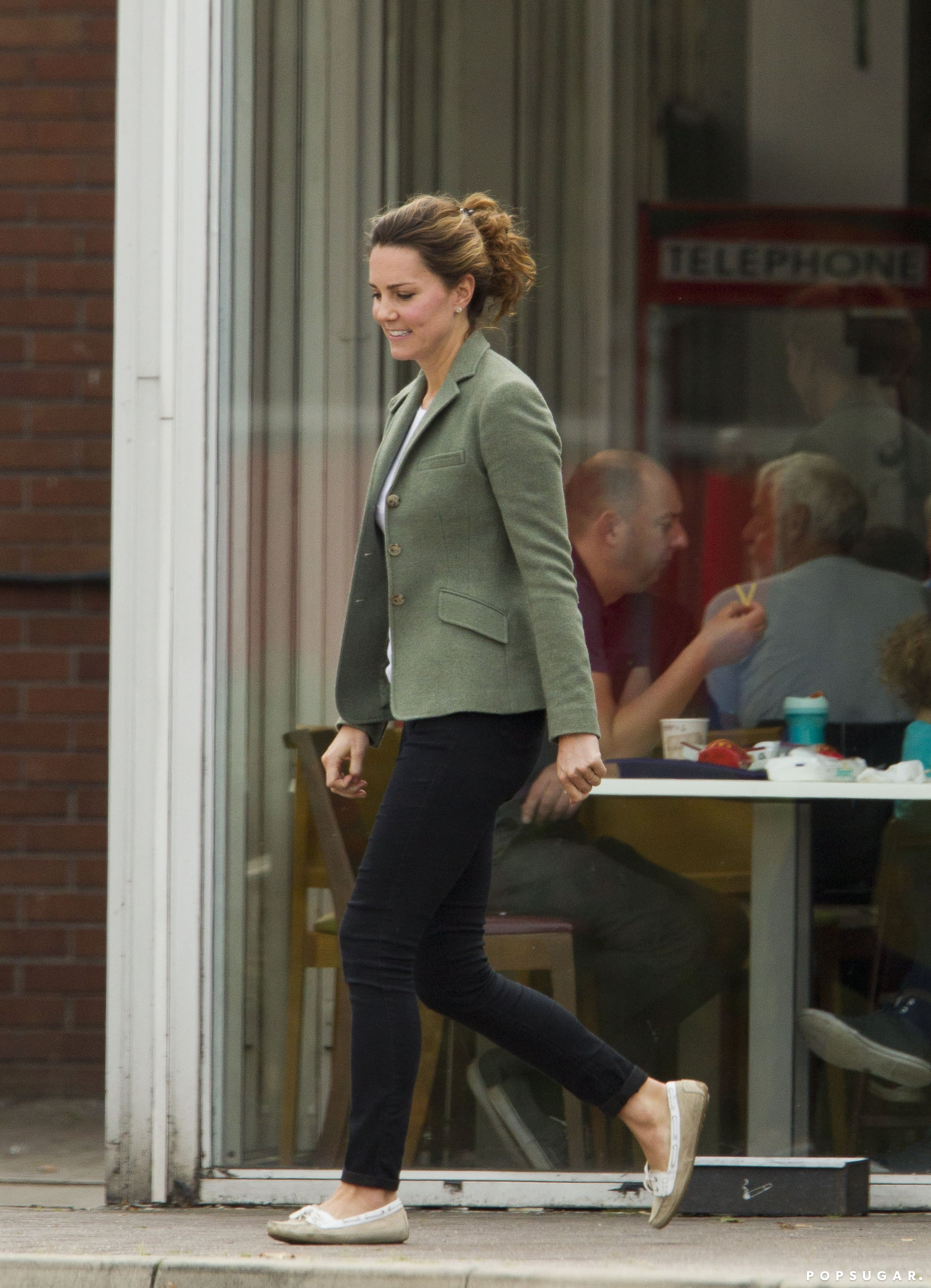 Kate Middleton wore a green blazer.
