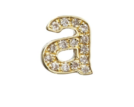 Tobey Maguire's wife, Jennifer Meyer, has made a name for herself by crafting exquisite and delicate jewelry that has become a favorite with It girls all over the world.  This Diamond Lowercase Stud Earring ($950) is a fun twist on the typical monogrammed item. Get a different letter for each ear for each of your initials. — Maria Mercedes Lara, associate editor
