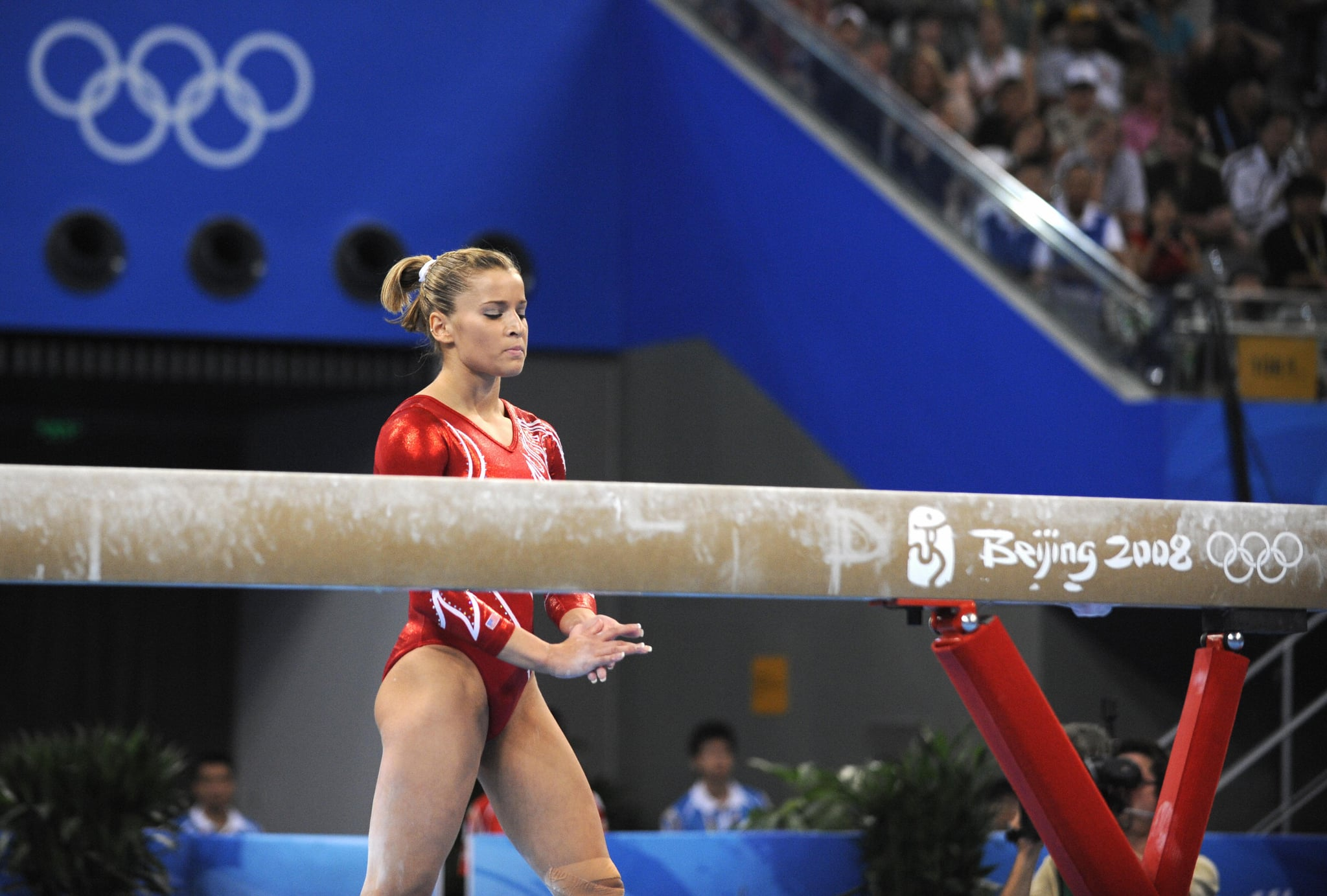 Alicia Sacramone goes back on the beam after falling.
