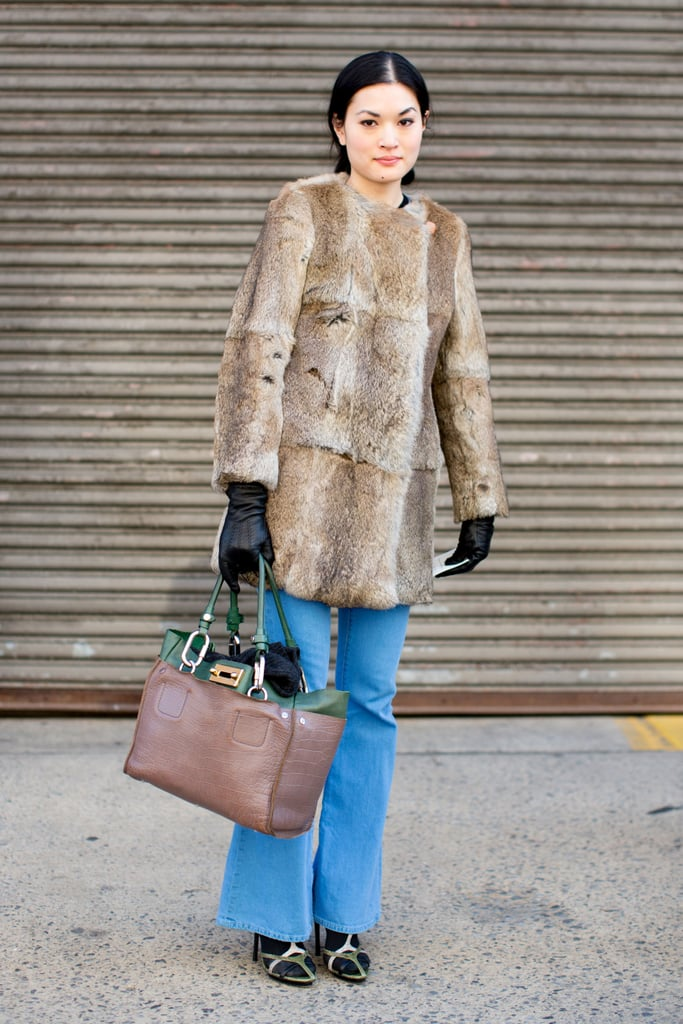 A fur coat transformed her flared denim with serious sophistication.