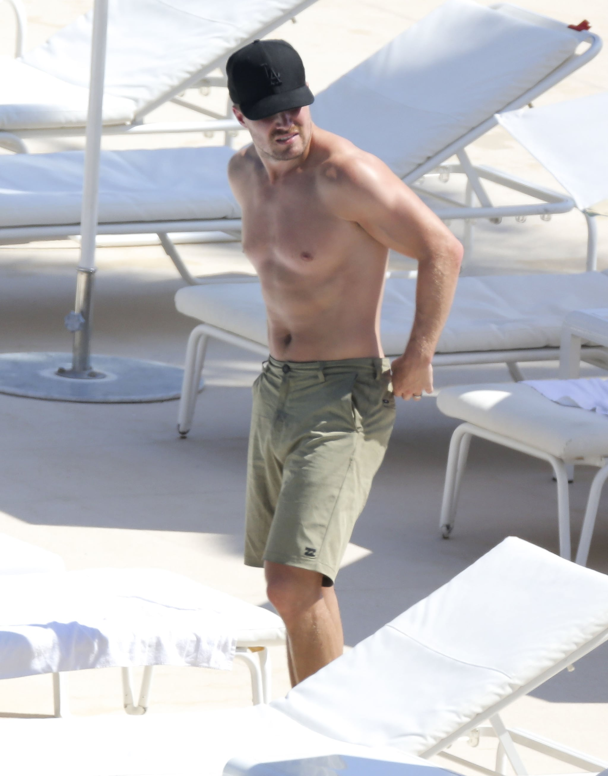 Stephen Amell showed off his fit body by the pool in Monaco in June.