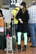 Jessica showcased her effortless take on neon, working a pair of vibrant green Current/Elliott ankle denim while arriving at LAX.