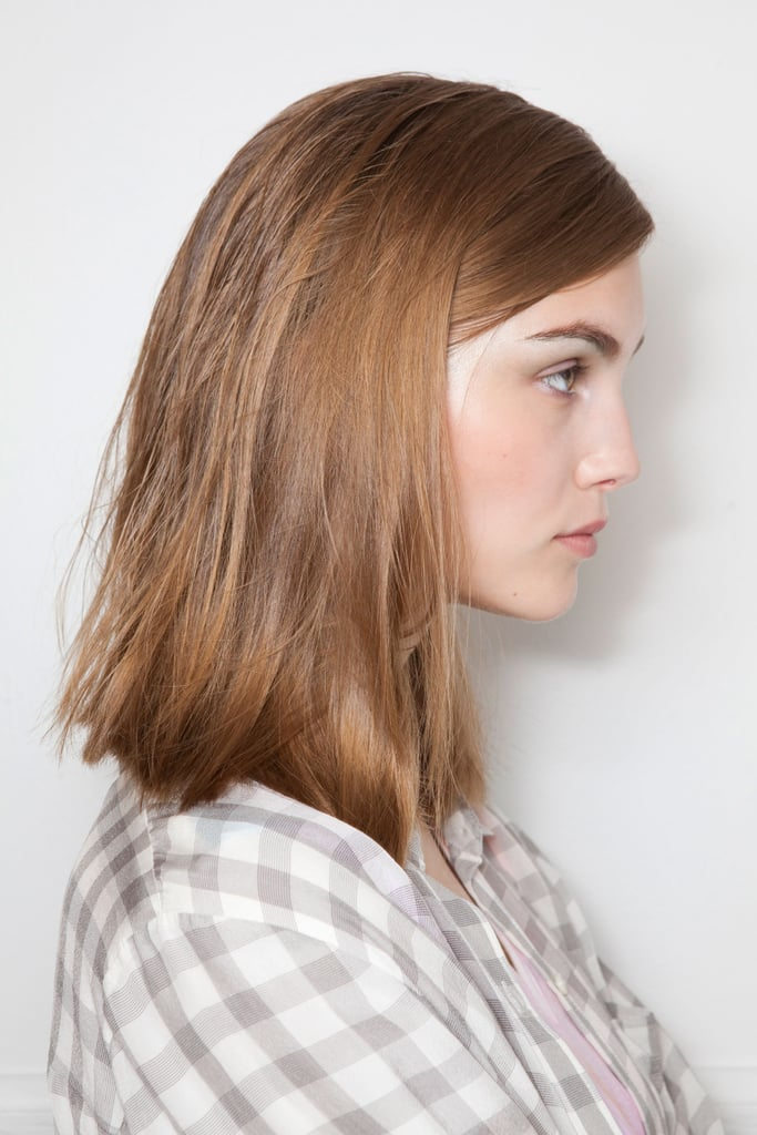 """Maybe because the economy is not that great, there is no time for flash or to be overdone,"" Pita explained. ""And fashion often reflects social issues."" To keep with this theme, stylists blow-dried the hair with their hands, then flat-ironed in a side to side motion to give it a slight wave."