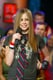 Avril Lavigne sported her usual tie during a 2002 TRL appearance.