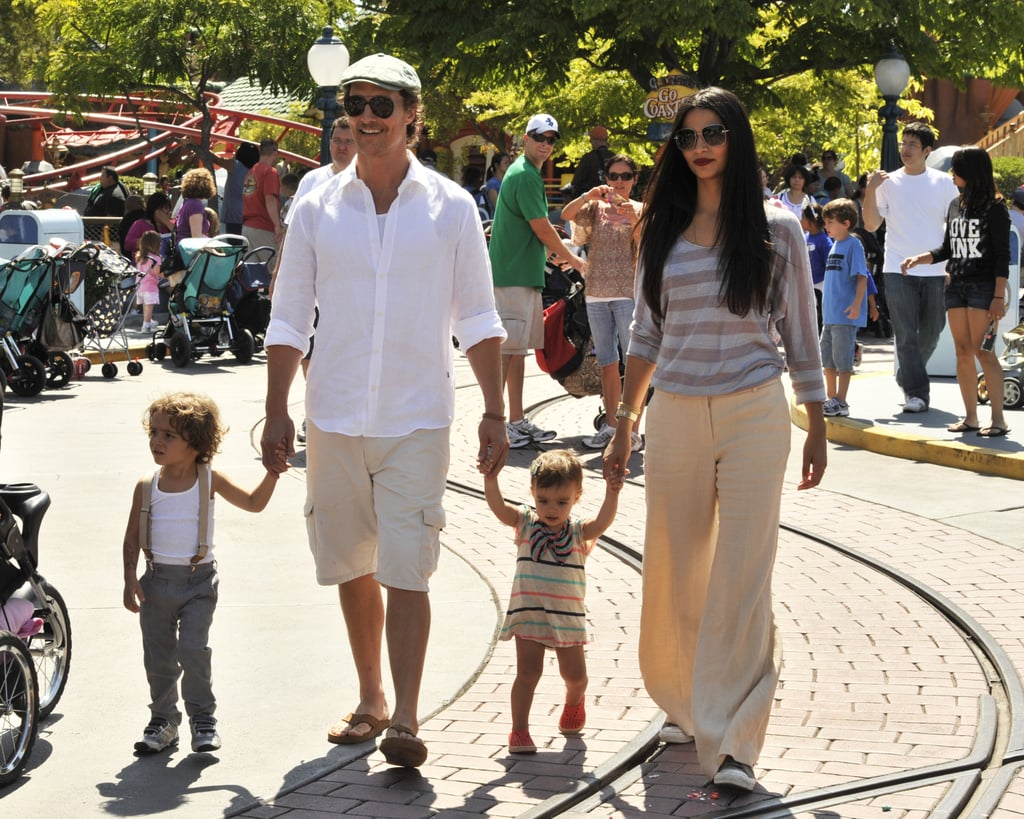 Matthew McConaughey and Camila Alves led Levi and Vida through the park in Summer 2011.