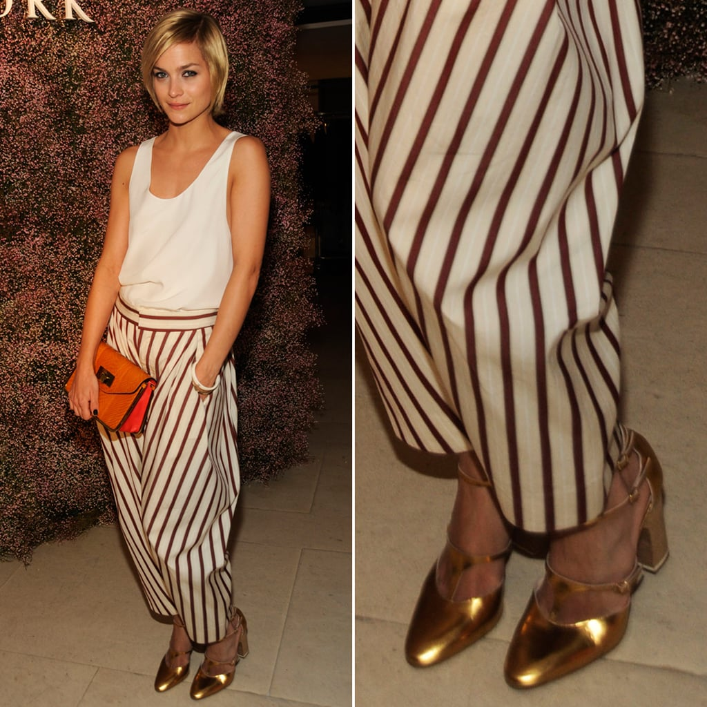 At a Barneys New York event in NYC, Leigh Lezark completed her striped trousers and orange clutch with shiny gold Mary Jane pumps.