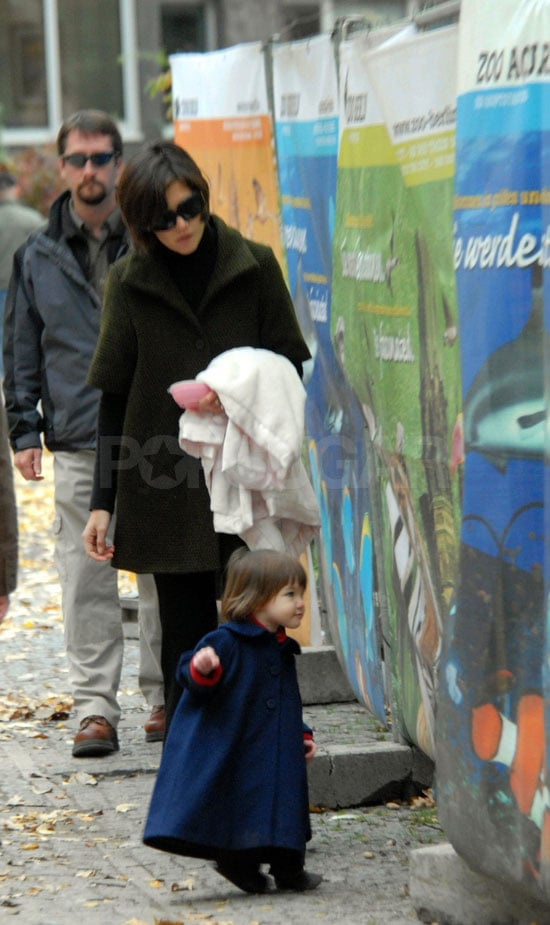 Suri Shows off Fancy Hairdo, Jacket and Bottles