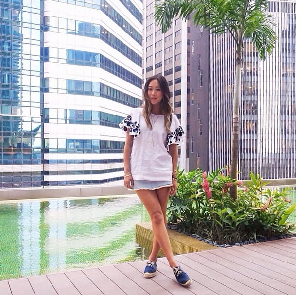 While we're all about Aimee Song's flouncy embroidered blouse, she added espadrille sneakers to complete the perfect errand-running outfit. Source: Instagram user songofstyle