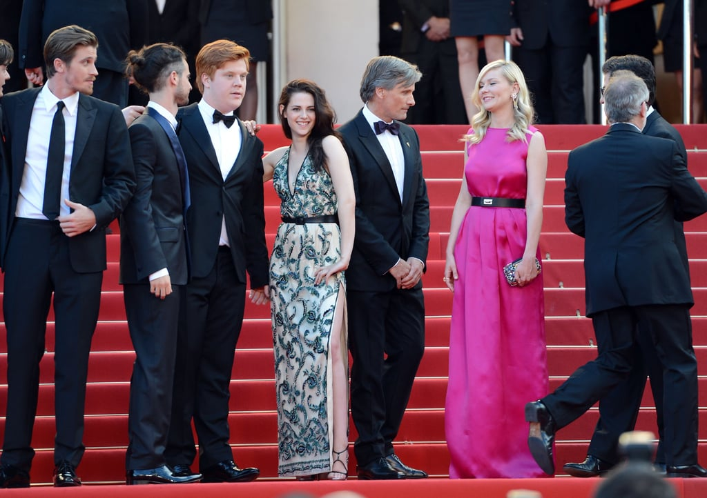 Kristen Stewart wore a sexy dress with a high slit and posed with Kirsten Dunst and the rest of the cast of On the Road for the premiere in Cannes.