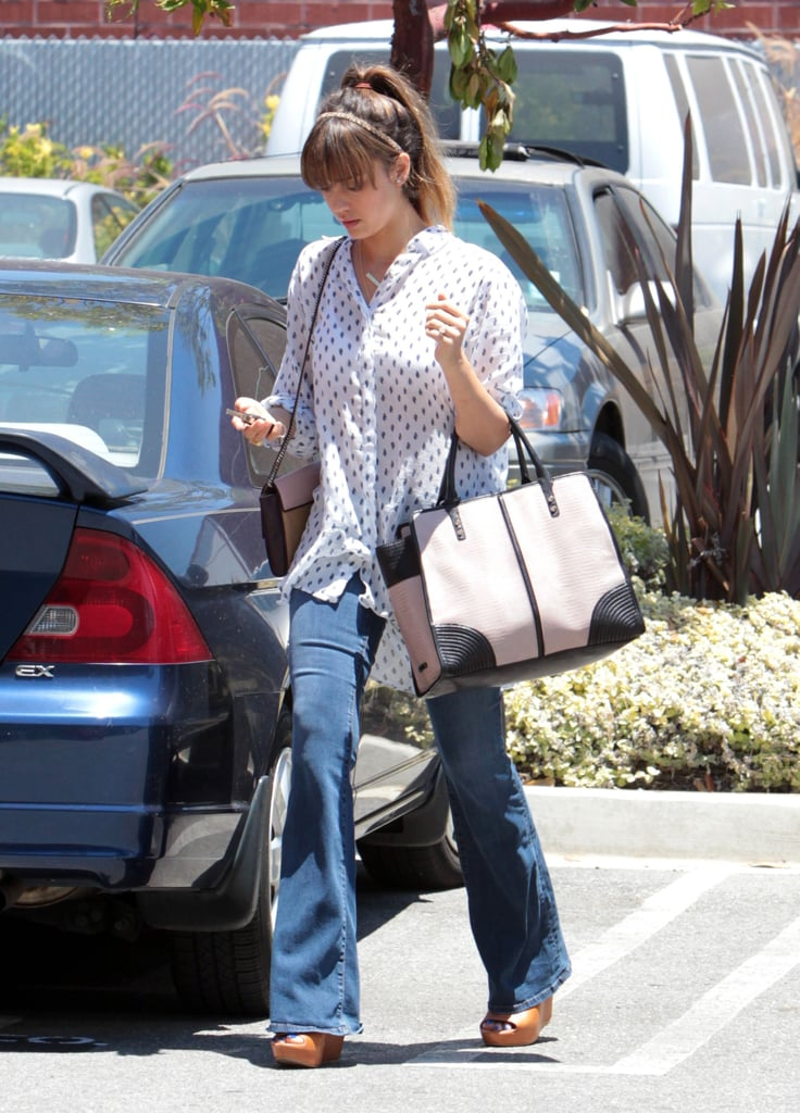 Give your wide-leg denim a summery spin with a breezy blouse and wedge sandals just like Jessica Alba.
