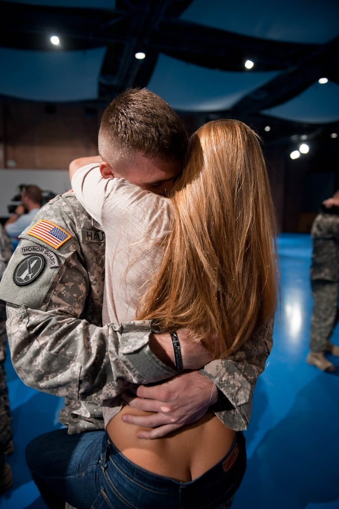A US Army soldier from Charlie Company, 1st Battalion of the 3rd Infantry Regiment, embraced his girlfriend after he returned from a yearlong deployment in Iraq at Fort Myer, VA, on August 28, 2010.
