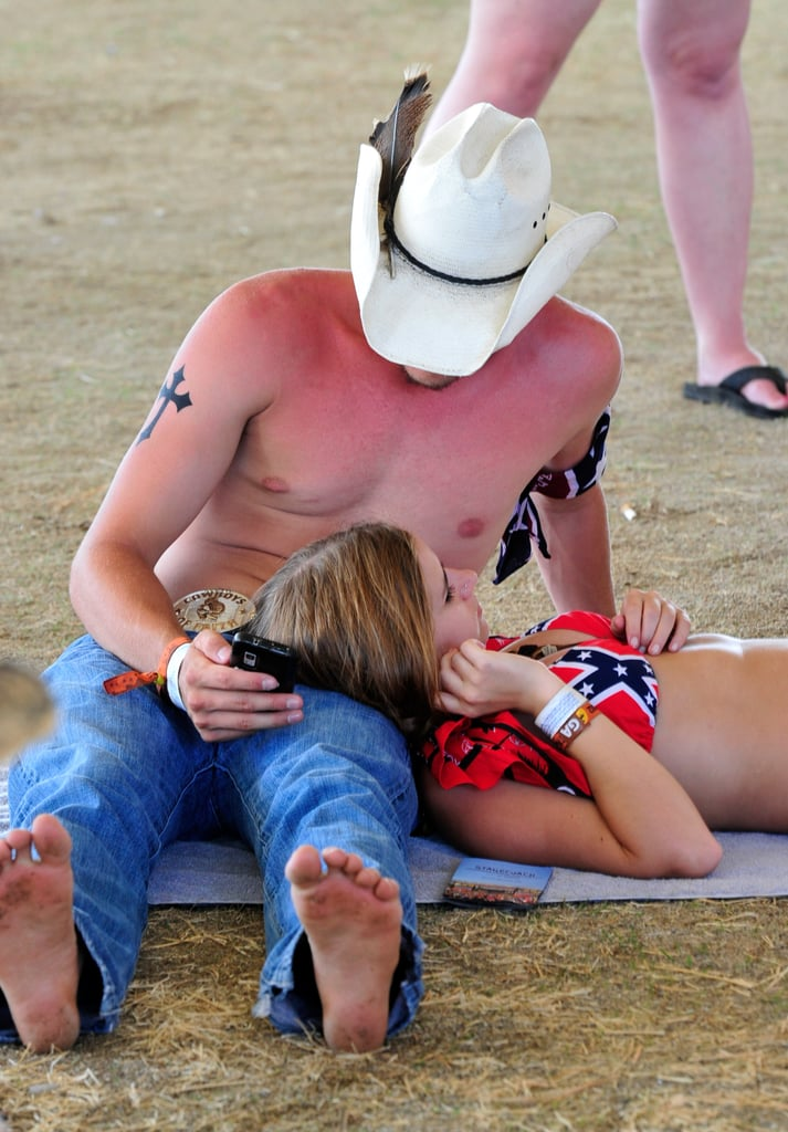 A couple got some sun at the Stagecoach Country Music Festival in Indio, CA.