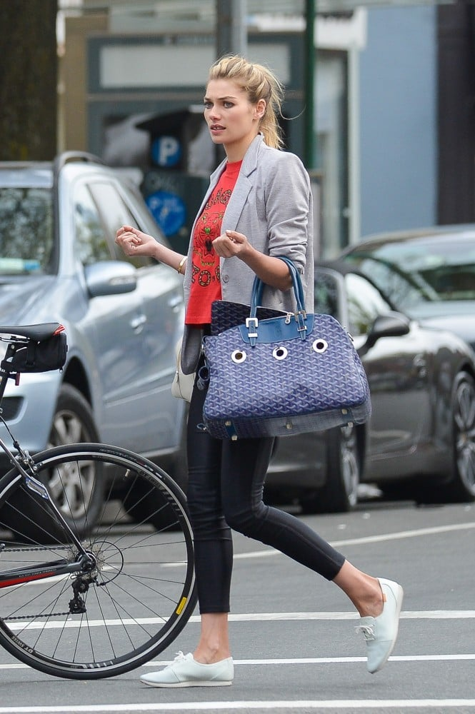 During a day out in NYC, Jessica Hart was menswear-inspired in a gray blazer, cropped pants, and lace-up sneakers.