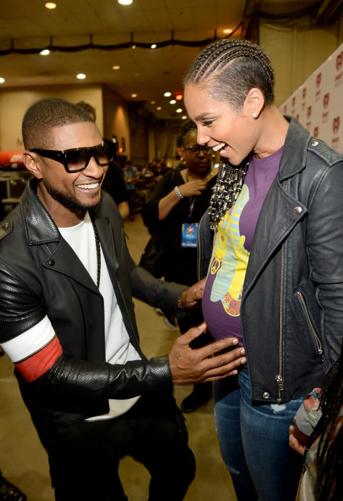 Usher couldn't help but rub Alicia Keys's growing baby bump while backstage at the iHeartRadio Festival in September 2014.