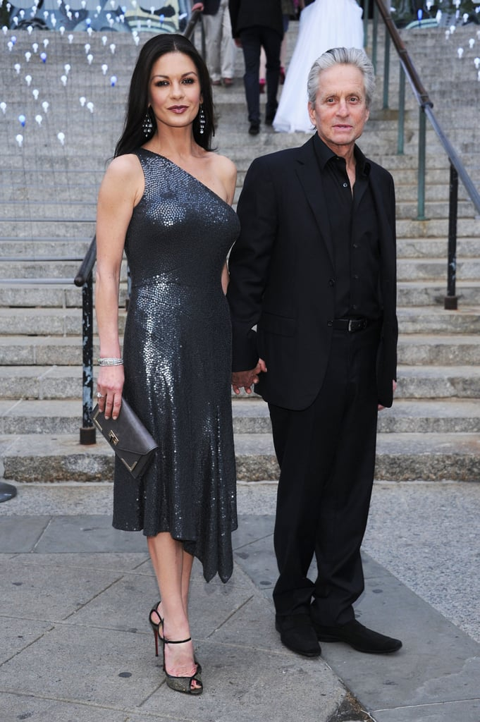 Catherine Zeta-Jones and Michael Douglas arrived at the Vanity Fair Party holding hands.