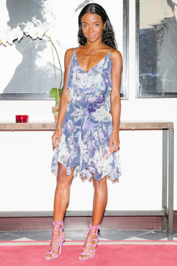 At the Voyage party, Genevieve Jones took a feminine turn in a flirty dress and pastel sandals.