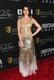 Olivia Munn lit up the carpet in a gold gown.
