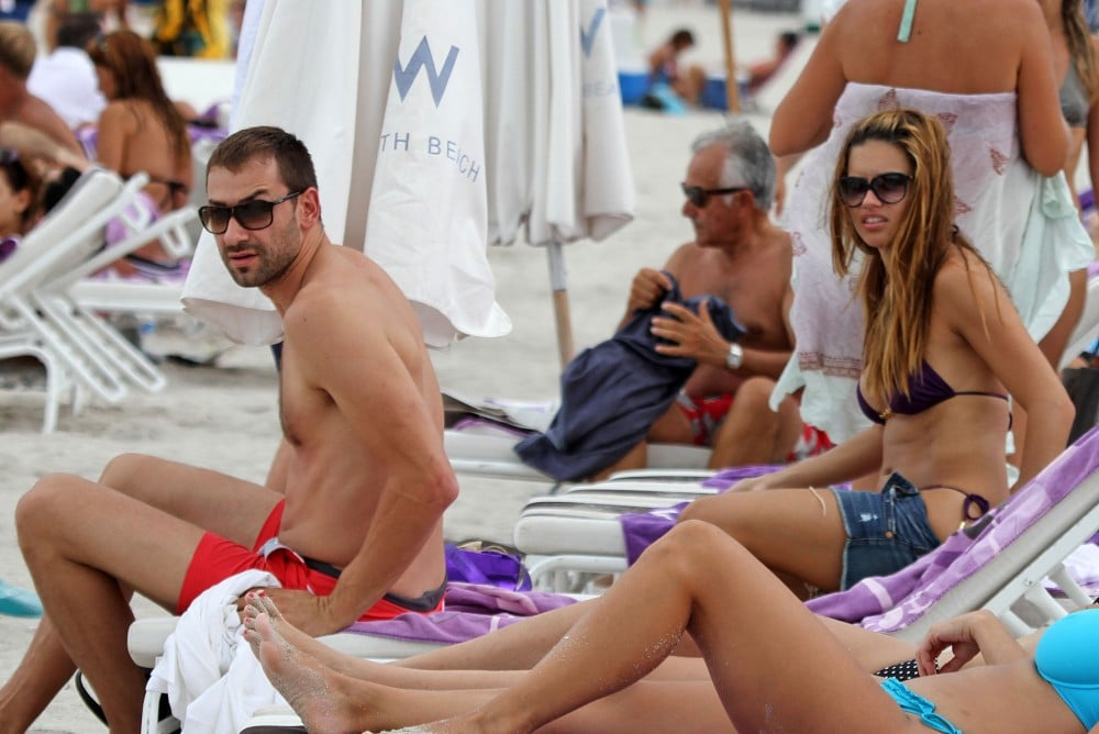 Adriana Lima donned a black bikini to lounge with her husband, Marko Jarić, during a getaway to Miami in August 2010.