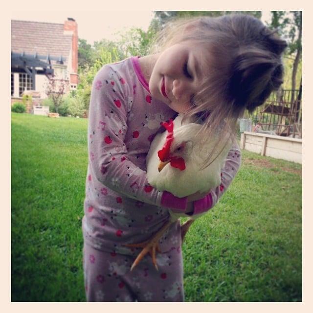 Harper Smith gave a little love to her chicken, Rose. Source: Instagram user tathiessen