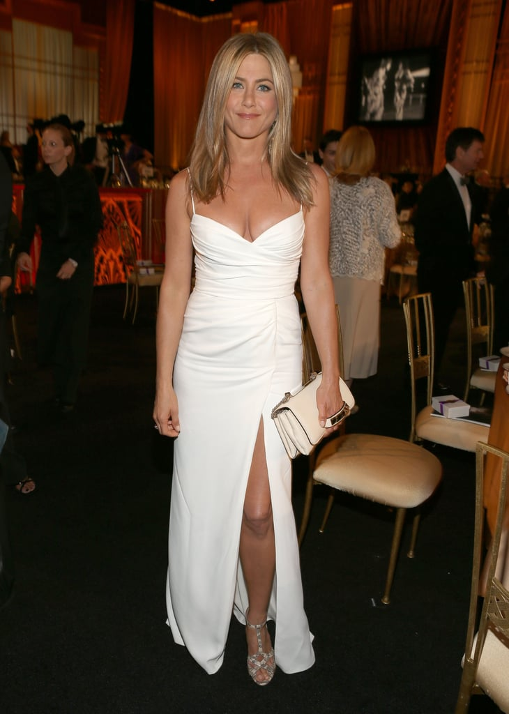 Jennifer Aniston wore white Burberry to an AFI event Thursday after going hot in black for Sunday's MTV Movie Awards.
