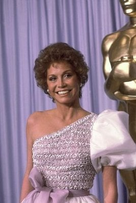 Curly-haired at the 1981 Academy Awards.
