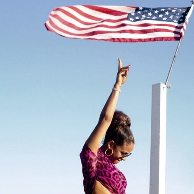 Christina Milian posed with a US flag. Source: Instagram user christinamilian
