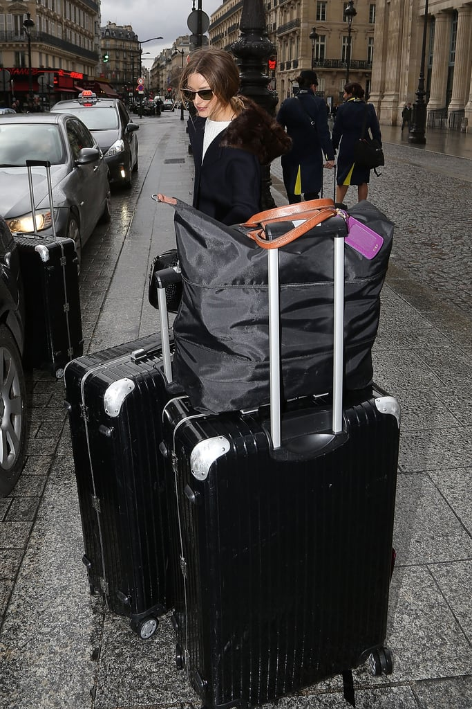 But had another (count 'em!) three large suitcases in tow and one roomy Longchamp tote.
