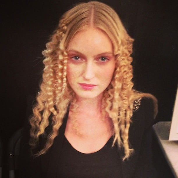 Are crimps coming back? This disco-ready hairstyle was spotted backstage at Reem Acra.