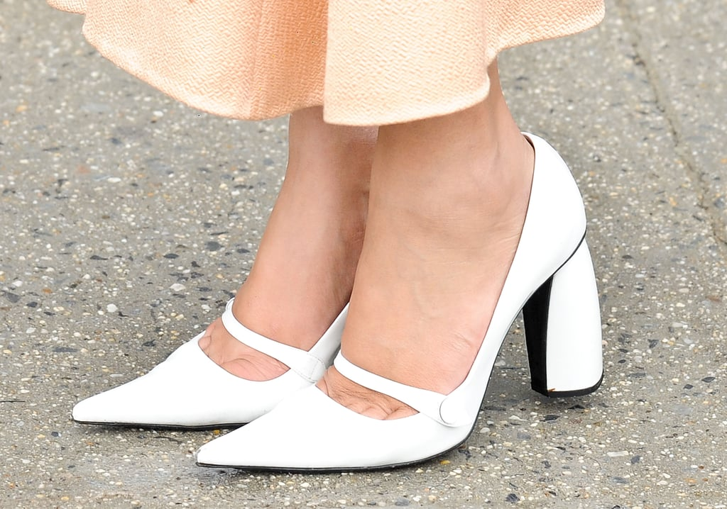 Nicole Warned showed off some chic white pumps.