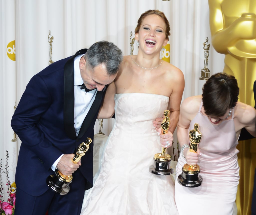 Daniel Day-Lewis, Jennifer Lawrence, and Anne Hathaway backstage at the Oscars 2013.