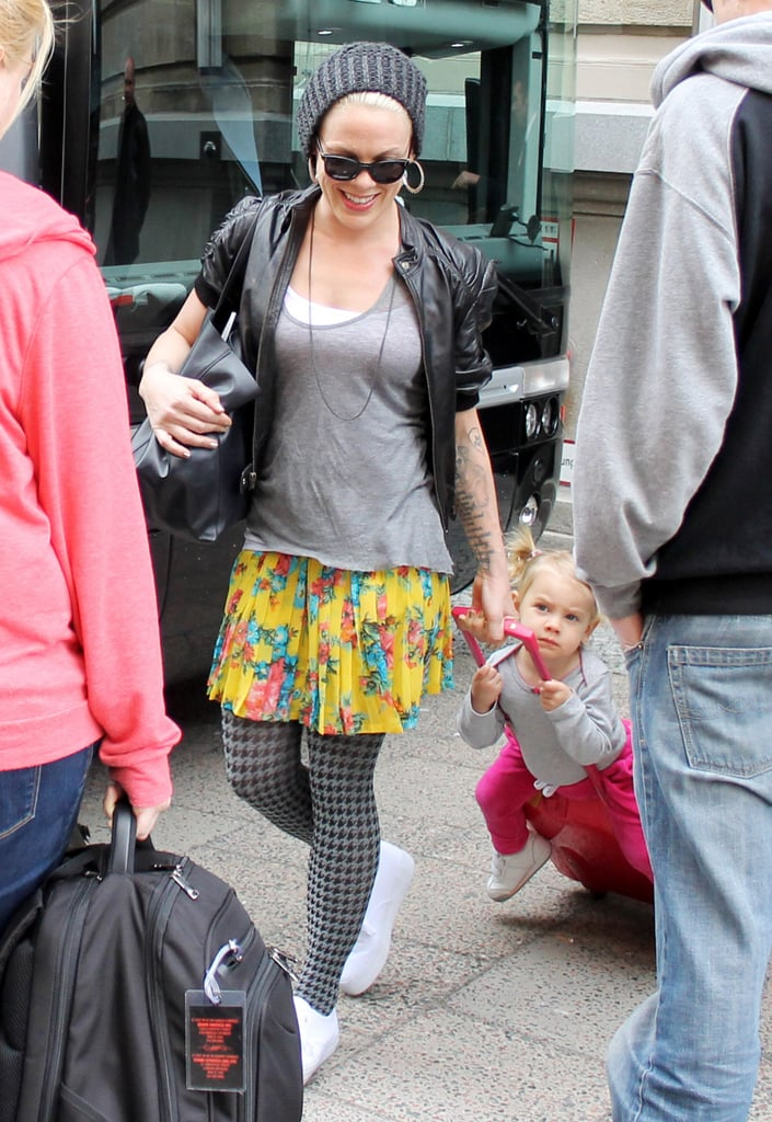 Pink and her daughter, Willow Hart, arrived at their hotel in Berlin on Sunday as Willow rode her luggage through the crowd.