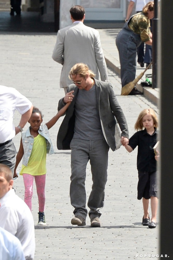 Brad Pitt Tours Russia With Shiloh and Zahara!