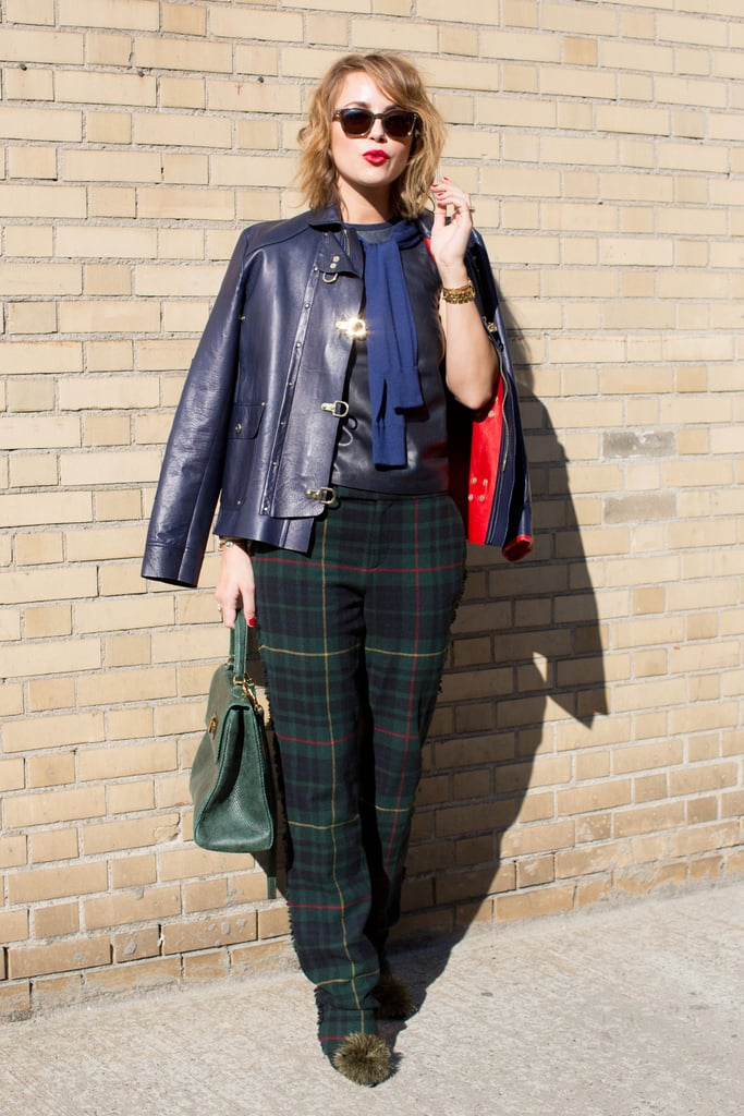 Kelly Framel was the picture of prep-meets-punk in plaid trousers and a navy leather jacket.
