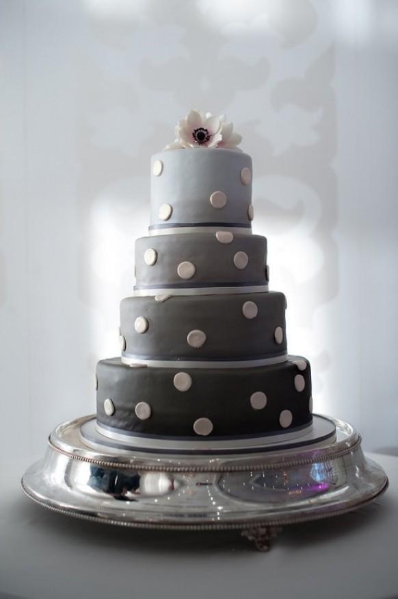 Ombré gray tiers modernize this cake's polka-dot detail.