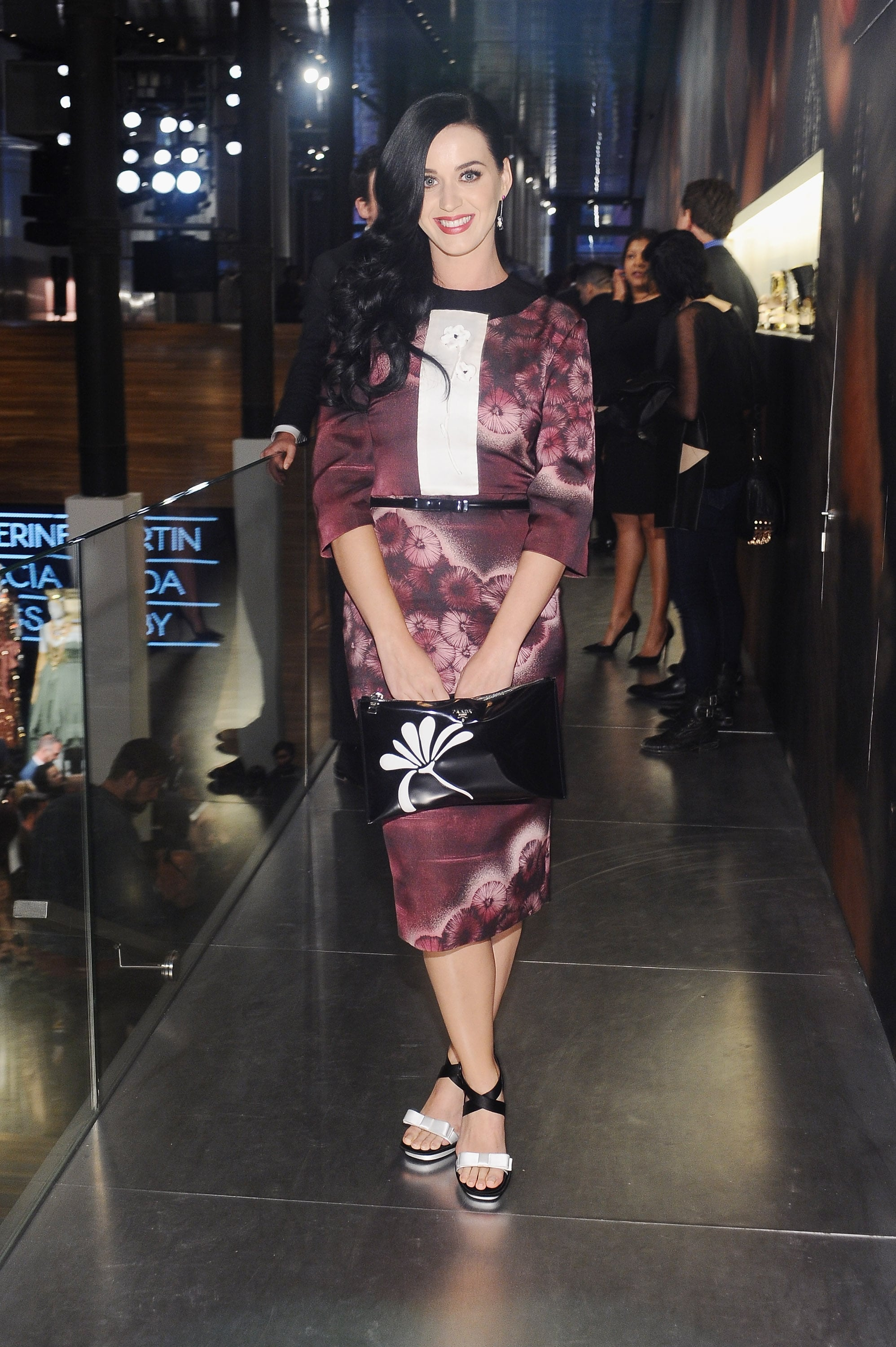 Katy Perry made a statement in a purple printed frock styled with a floral clutch and black and white platform sandals — all from Prada — at the  Prada and The Great Gatsby soiree.