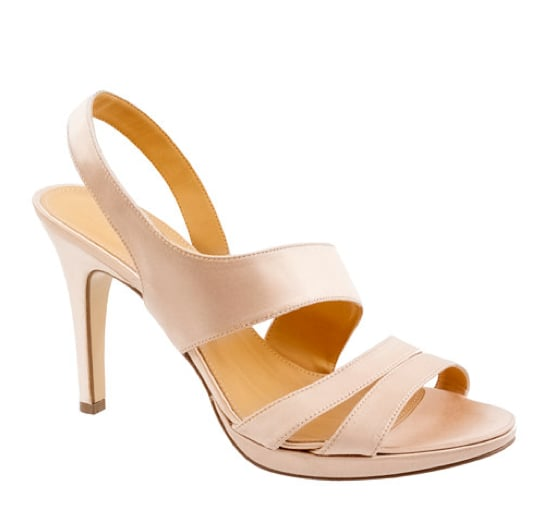 "Offset your white wedding day with an elegant, albeit asymmetrically strapped, pair of ivory-hued heels. The slingback and platform ""padding"" will provide more comfort than your average sky-high heel.  J.Crew Georgine Platform Heels in Ivory ($235)"