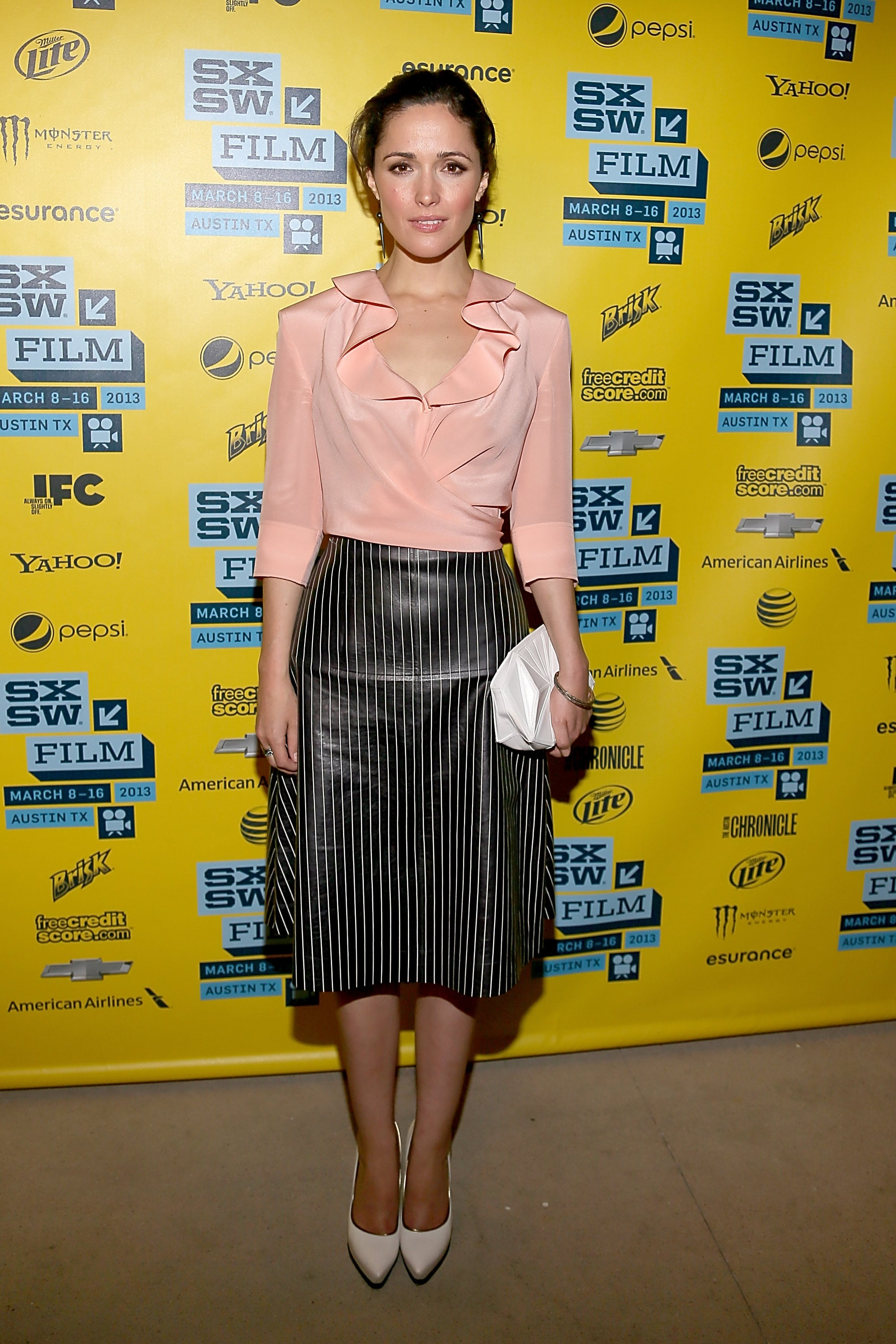Rose Byrne paired an ultrafemme ruffled top with a full, pinstriped skirt and Pearl Collective jewels for a modern take on ladylike at the I Give It a Year premiere.