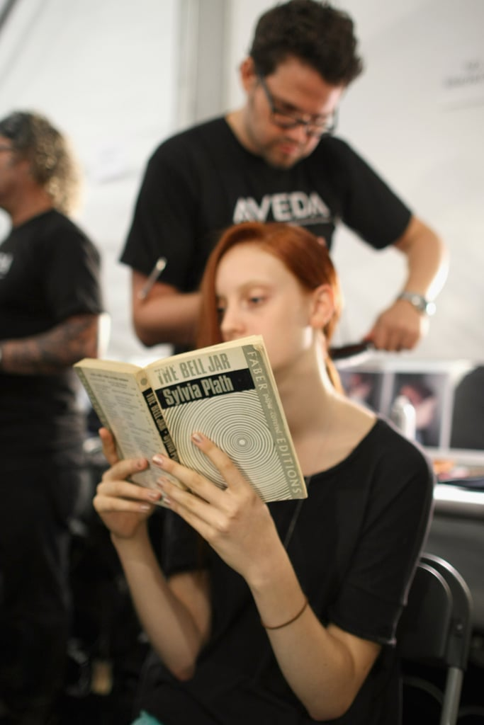 A model was snapped reading Sylvia Plath's The Bell Jar backstage at the Richard Chai — Love show during Spring 2013 Mercedes-Benz Fashion Week.