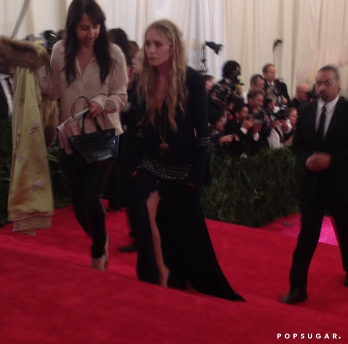 Mary-Kate Olsen donned vintage Chanel and had an assistant carrying her fur.