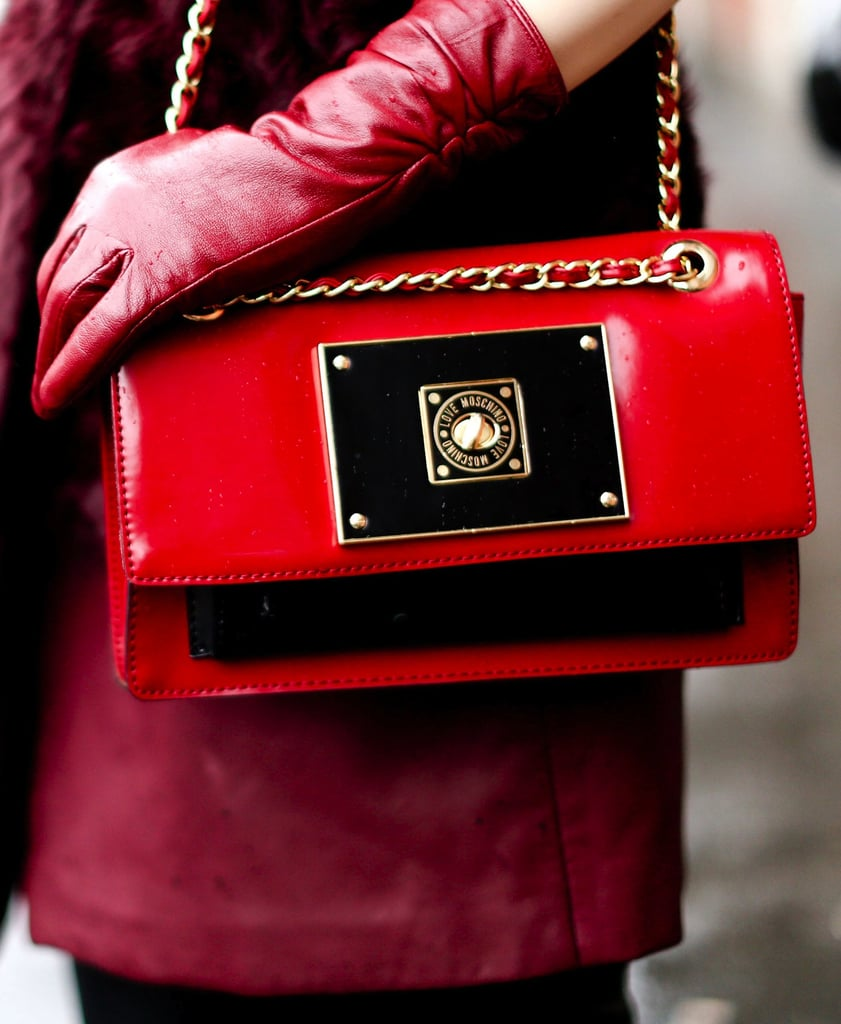 A red patent-leather chain bag completed the look.